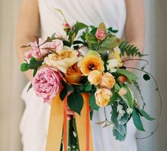 Wedding Bouquet Featuring Lovely Ingredients: Pink/Orange/Yellow-Orange Garden Roses, Orange/Yellow  Roses & Buds, Dusty Miller + Other Misc. Greenery/Foliage Hand Tied With Orange Ribbon