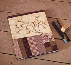 Protect a notebook or sketch book in a cute patchwork cover. Free pattern!