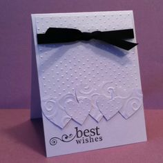Best Wishes wedding card, in white embossed papers with hearts and black ribbon