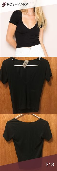 Brandy Melville Alice Top V-neck ribbed top, NWT. One size fits most, probably best fits a small Brandy Melville Tops Tees - Short Sleeve