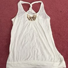 White Racerback Tank with Brown and Bronze Sequins White racerback tank with a crinkly-looking design. Has some brown, bronze, and tan sequins in a small semi-circle at the top. Looks really cute with a cardigan or jacket. No signs of wear stains, or damages of any sort. Smoke free home. Tops Tank Tops