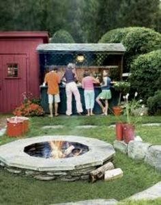 Backyard Fire Pit -- Adding a fire pit is one way to create an outdoor kitchen. A bar extends the usefulness of the space for outdoor dining. Garden Fire Pit, Diy Fire Pit, Fire Pit Backyard, Outdoor Fire, Outdoor Living, Outdoor Barbeque, Gazebo, Outside Fire Pits, Fire Pit Materials