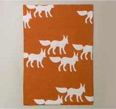 Foxes Graphic Knit Blanket by Dwell Studio: I'm obsessed with foxes right now. SO I hope Max loves this beautiful blanket that blends perfectly with his woodland-ish motif.  #StyleSquared