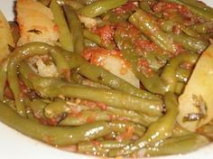 This is another easy to make Greek recipe. It's a… Fresh Green Beans (Fasolakia). This is another easy to make Greek recipe. It's a delicious lunchtime meal, especially when accompanied by a slice of Feta cheese. Veggie Dishes, Veggie Recipes, Vegetarian Recipes, Cooking Recipes, Potato Recipes, Greece Food, Macedonian Food, Greek Dishes, Greek