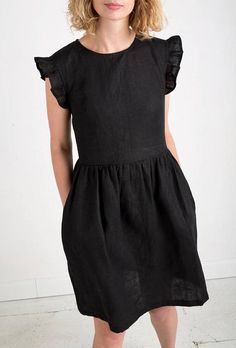 Black linen dress with ruffled sleeves.  --------------------------------------------------------------------------------------------------------  ABOUT:  Beautiful handmade black linen dress. Made from locally manufactured pre-washed linen fabric and is perfect for all seasons.