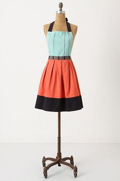 anthropologie apron - use as inspiration for a dress or skirt.... pintucks, turquoise, coral, brown color pallette, wide border