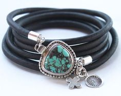 Turquoise and sterling silver leather wrap bracelet.  The focal point of this multi wrap bracelet is a gorgeous natural AAA Carico Lake