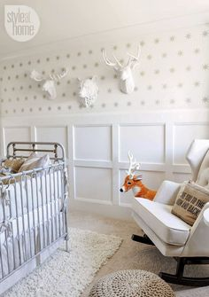 DECORATING WITH FAUX ANIMAL HEADS -> 22Crowns.com // white, faux, animal heads, nursery, neutral, nurseryworks rocker, wainscoting