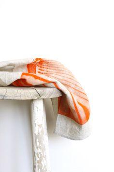 linen tea towel in orange photograph by mueluandjones on etsy