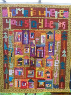 Lajla's Home quilt is a sampler with UnRuly Letters, houses, trees, hearts, cupcakes and mugs. Doesn't it just glow?