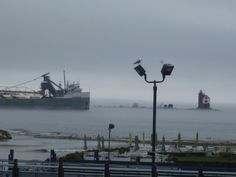 Freighter passing through Round Island channel  on a foggy day. Round Island Lighthouse and Mackinac Island, Michigan