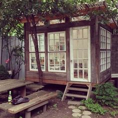 Outdoor office in the backyard with lots of windows