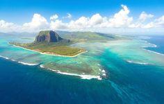 Mauritius, Africa. Maurício, a 8ª melhor ilha do mundo segundo o Travellers' Choice, é um paraíso tropical com muito a oferecer. Port Louis, a moderna capital dessa ilha de 61 por 46 km, é um porto movimentado com uma área à beira-mar revitalizada e um mercado ativo. No entanto, a maioria dos visitantes circulam pelas regiões dos resorts, como Mont Choisy, a tranquila Trou-aux-Biches e a agitada Flic en Flac, popular entre os mergulhadores. Rivière Noire é ideal para aqueles que querem…