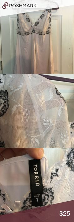 Torrid White & Black Lace Slip This Torrid Slip of a size 1 or 14 and has sheer cups embroidered with black and white Lace flowers. Please look at the size chart for your measurements before purchasing. No trades or low ball offers. Thanks! torrid Intimates & Sleepwear Chemises & Slips
