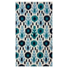 Hand-tufted rug with an abstract motif.