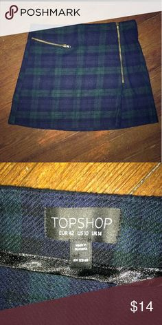 "Topshop plaid mini skirt Navy blue, green and black plaid mini from topshop. No flaws, gold functional zipper. 16"" across and 16"" long Topshop Skirts Mini"