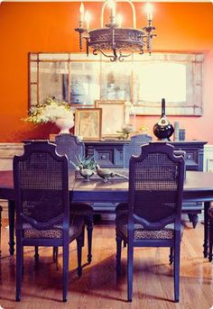 Orange Dining Room With Leopard Chairs And Lantern
