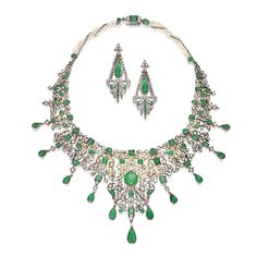 Silver, Gold, Emerald, Diamond and Pearl Necklace and Earclips. The bib-style necklace and earclips of elongated design, the necklace centering an octagonal-shaped emerald, accented by round, square and pear-shaped emeralds and emerald beads, further set with rose-cut diamonds, the backchain composed of 162 seed pearls; the earclips centering two pear-shaped emeralds, accented by calibré-cut emeralds and rose-cut diamonds.
