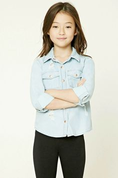 Forever 21 Girls - A chambray shirt featuring a distressed design, basic collar, a snap-button front, two front flap snap-button pockets, a curved hem, and long snap-button cuff sleeves.