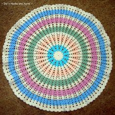 Make your very own round crochet afghan with the Ferris Wheel Baby Blanket pattern. Rounds of pastel colors make this crochet baby blanket pattern light and eye-catching. Baby Afghans, Crochet Afghans, Baby Blanket Crochet, Crochet Baby, Baby Blankets, Crochet Blankets, Crochet Stitches, Crochet Round, Easy Crochet