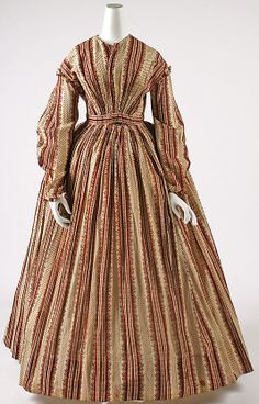 Dress    Date:      1864–66  Culture:      American  Medium:      cotton  Dimensions:      Length at CB: 54 in. (137.2 cm)  Credit Line:      Gift of Mrs. William R. Witherell, 1953  Accession Number:      C.I.53.72.7