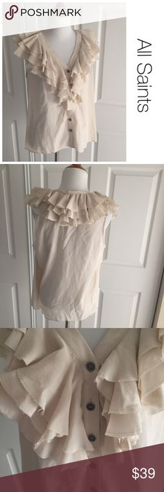 All Saints Spitafields silk ruffle blouse size 6 ♦️No stains or piling. There are some small holes as pictured. They are very unoticable as one is under the ruffle area and the other is close to the armpit area. ♦️100 % silk  ♦️Measurements:                               ♦️Laying flat armpit to armpit: approximately  inches                       ♦️Laying flat from the back of the neck to the bottom of the front hem is approximately inches All Saints Tops Blouses
