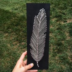 Feather String Art by MagnoliaDesignEE on Etsy, I like the thick nail heads on this one-- It looks nice with the nails close to each other, wouldn't look good spread apart too much Adult Crafts, Diy And Crafts, Arts And Crafts, Nail String, String Art, Magnolia Design, Feather Crafts, Thread Art, Camping Crafts