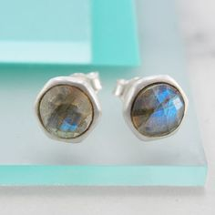 Beautiful and divine, these handmade round sterling silver stud earrings feature a hand-cut semi-precious labradorite stone. #Embersjewellery #Jewellery #accessories #giftforher #labradorite