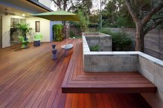 Inviting Porches Design for Your Outdoor Living Ideas: Modern Porches With Outdoor Deck Designs And Contemporary Outdoor Furniture Also Built In Benches With Concrete Block Wall And Wood Fence Plus Climbing Trees ~ franklester.com Architecture Inspiration