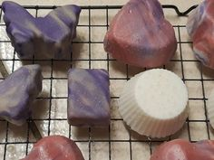 Mirror glaze soap attempt 1 and 2 in the purple. Not brilliant but I'm a beginner. They were not salt bars and have not sweated like the soap bars have. Notice the beads of water on the pink heart? Bar Soap, Purple, Pink, Glaze, Salt, Challenge, Beads, Mirror, Water
