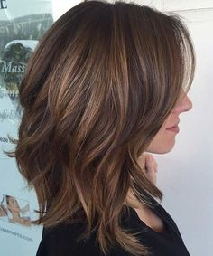 Cute brunette highlighted shoulder-length medium hair with long shaggy layers