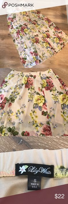 🌷final price reduction🌷Floral sheer skirt This maxi long floral sheer skirt(41 1/2 inches long)  has a short under slip.(14 1/2 inch long). I bought it at Nordstrom BP and only wore it once. It's adorable I didn't have a cute tank to wear with it. Pair it with denim jacket. Size small. Elastic waste. No buttons. Waste is 12 1/2 inches seam to seam but has a lot of stretch in the elastic. Lily White Skirts Maxi