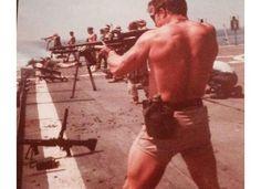 Here is a Navy SEAL firing from an aircraft carrier during the Vietnam War.