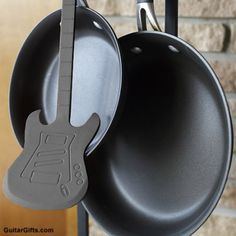 Guitar Spatula - How cool is this! A cooking spatula in the shape of an electric guitar. Perfect for the kitchen for any musician's home or simply any music lover's home. Would make a cool housewarming gift too.