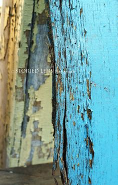 Study the lines and imagine the story behind the paint, the tales in the cracks, the feel and texture in the layers of this peeling paint.  The vibrant turquoise and yellow paint catch your eye and the deep cracks in the wood reveal rich texture. Photograph is protected by COPYRIGHT: Jocelyn Cook of Storied Lens. To view more of my work visit the Storied Lens ETSY shop, my website and become a fan on Facebook.  www.storiedlens.com