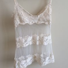 American Rag- Crochet Off-white Sheer sexy tank Very sexy. Bodice is lined so it works perfectly with a bra or bandeau. Works with a tank underneath too. Peek-a-boo sheer lining. American Rag Tops Tank Tops