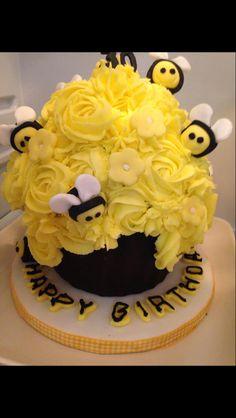 Busy Bees Nursery Birthday celebration Giant Cupcake - vanilla sponge with bright yellow rose swirl icing & cute little fondant bee decorations