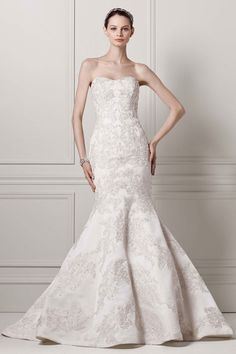 Wedding gown by Oleg Cassini at David's Bridal- Tried this one on. was gorgeous but too much train for destination wedding !
