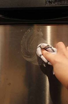 Someone asked me about removing water stains from the front of a stainless steel dishwasher the other day and I wasn't sure if I could figure out how to resolve that problem. Then it dawned on me…why not use our DIY Kitchen Sink Cleaner recipe?! It worked perfectly for the sink, so it should work