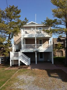 Comfortable and close to everything. There are 5 bedrooms with 3 1/2 baths plus an additional TV room off of the living room. 1/2 a block to the beach. Nice open air decks on the front of the home. Parking for 5 cars. Call Crowley Real Estate for Details. 1800-732-7433