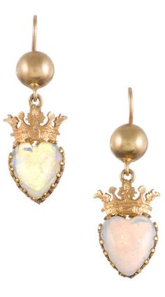 15k yellow gold English Victorian earrings consisting of a carved heart-shaped opal, suspended from a golden crown and orb. 1.25 inches long and just shy of a half inch wide. circa 1890.