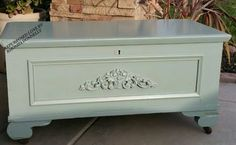 100 year old cedar chest transformed in General Finishes Persian Blue Milk Paint. An added decorative wood applique was added.