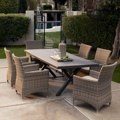 Bella All Weather Wicker Patio Dining Set - Seats 6 - Patio Dining Sets at Hayneedle - WICKER!!!  Don't think my hubby will agree though.