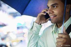 """Laden Sie das lizenzfreie Foto """"Businessman with an Umbrella Talking on a Cell Phone"""" von corbis_infinite zum günstigen Preis auf Fotolia.com herunter. Stöbern Sie in unserer Bilddatenbank und finden Sie schnell das perfekte Stockfoto für Ihr Marketing-Projekt!"""