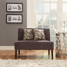 Give your living room a contemporary kick with this loveseat.