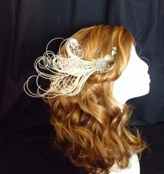Hey, I found this really awesome Etsy listing at https://www.etsy.com/listing/212823805/ivory-curled-feather-and-crystaled