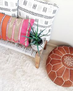 Traditional textile. Using traditional mudcloth techniques, African artisans handcraft this bold dashed throw pillow. Each pillow features hand-drawn designs from local traditions. Looks great on your