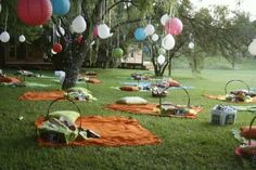 Picnic baskets and blankets instead of tables for an outdoor wedding reception!