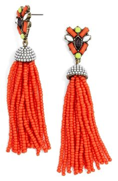 So festive! Faceted crystals and swishy beaded tassels create bohemian allure on these statement-making drop earrings.