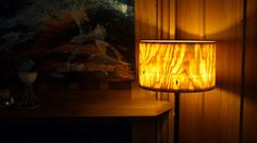 One-piece wooden lamp shade turned from a section of a tree.